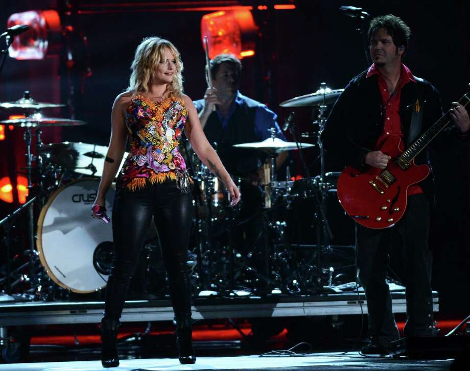 NASHVILLE, TN - NOVEMBER 01:  Miranda Lambert performs during the 46th annual CMA awards at the Bridgestone Arena on November 1, 2012 in Nashville, United States. Photo: Jason Kempin, Getty Images / 2012 Getty Images