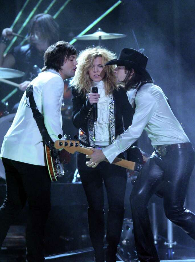 NASHVILLE, TN - NOVEMBER 01:  (L-R) Neil Perry, Kimberly Perry, and Reid Perry of The Band Perry perform during the 46th annual CMA Awards at the Bridgestone Arena on November 1, 2012 in Nashville, Tennessee. Photo: Jason Kempin, Getty Images / 2012 Getty Images