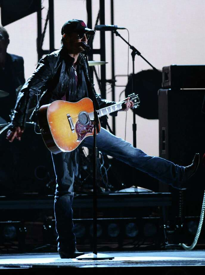 NASHVILLE, TN - NOVEMBER 01:  Eric Church performs during the 46th annual CMA Awards at the Bridgestone Arena on November 1, 2012 in Nashville, Tennessee. Photo: Jason Kempin, Getty Images / 2012 Getty Images