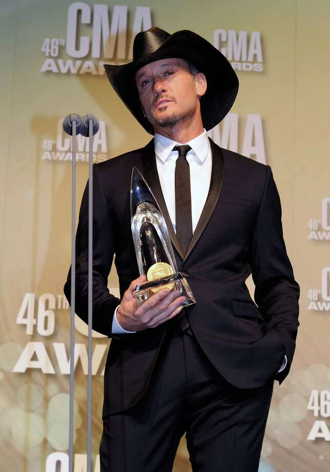 NASHVILLE, TN - NOVEMBER 01:  Tim McGraw poses with award at the 46th annual CMA Awards at the Bridgestone Arena on November 1, 2012 in Nashville, Tennessee. Photo: Erika Goldring, Getty Images / 2012 Getty Images