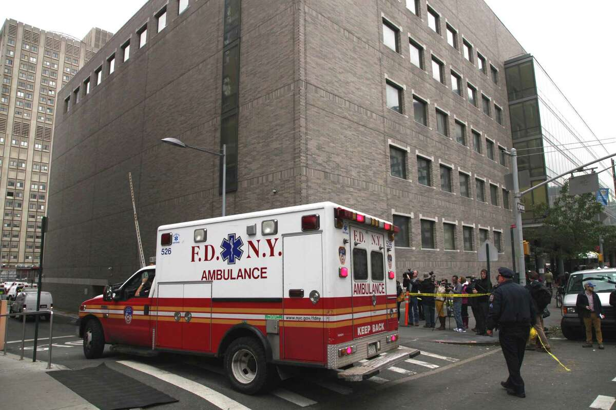 In this Wednesday, Oct. 31, 2012 photo, an ambulance departs Bellevue Hospital in New York where patients were being evacuated. Efforts to defend two of the city?'s busiest, most important medical centers against flood broke down during superstorm Sandy this week. Nearly 1,000 patients had to be evacuated from NYU Langone Medical Center and Bellevue Hospital Center after backup power systems failed when their basements flooded. (AP Photo/Mark Lennihan)