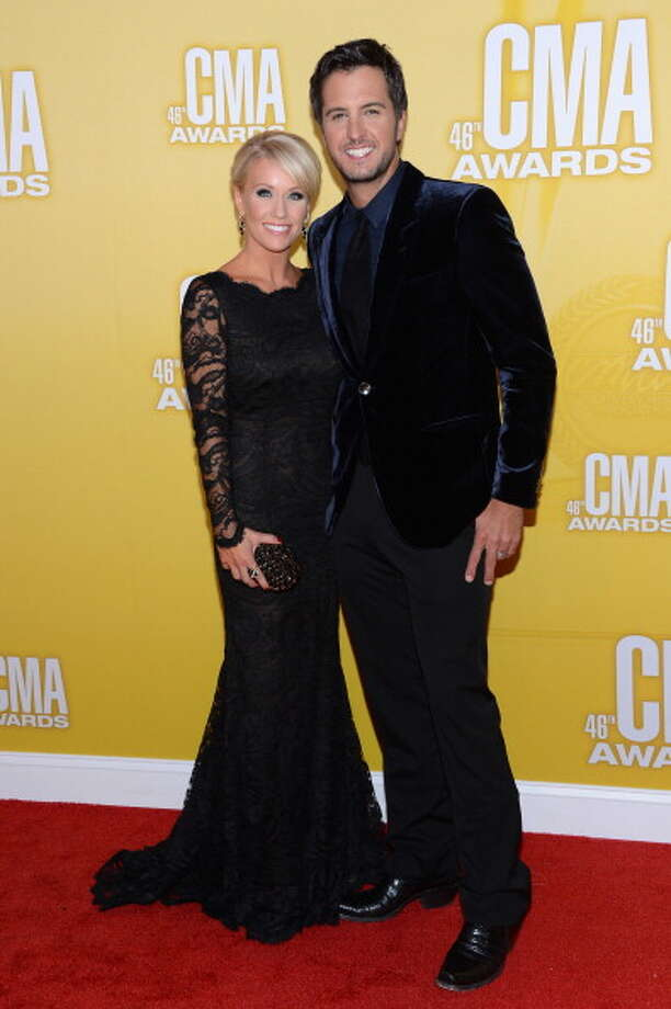 Country music artist Luke Bryan (R) and Caroline Boyer attend the 46th annual CMA Awards at the Bridgestone Arena on November 1, 2012 in Nashville, Tennessee. Photo: Jason Kempin, Getty Images / 2012 Getty Images
