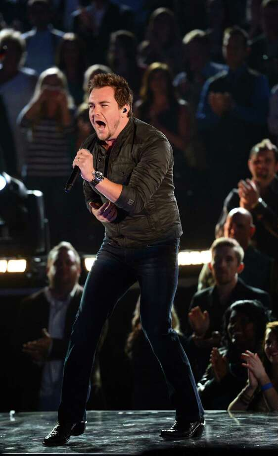 NASHVILLE, TN - NOVEMBER 01:  Mike Eli of The Eli Young Band performs during the 46th annual CMA Awards at the Bridgestone Arena on November 1, 2012 in Nashville, Tennessee. Photo: Jason Kempin, Getty Images / 2012 Getty Images