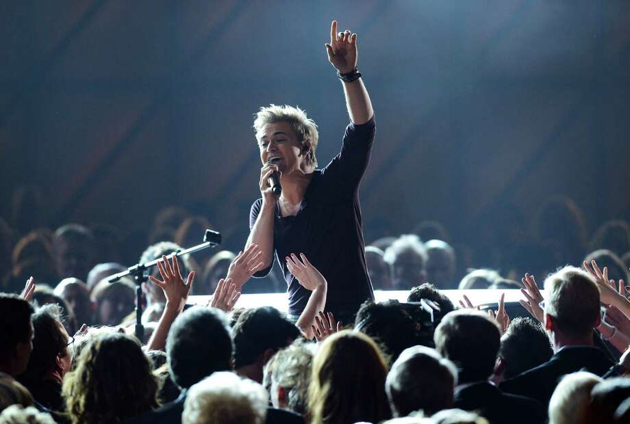 NASHVILLE, TN - NOVEMBER 01:  Hunter Hayes performs during the 46th annual CMA Awards at the Bridgestone Arena on November 1, 2012 in Nashville, Tennessee. Photo: Jason Kempin, Getty Images / 2012 Getty Images