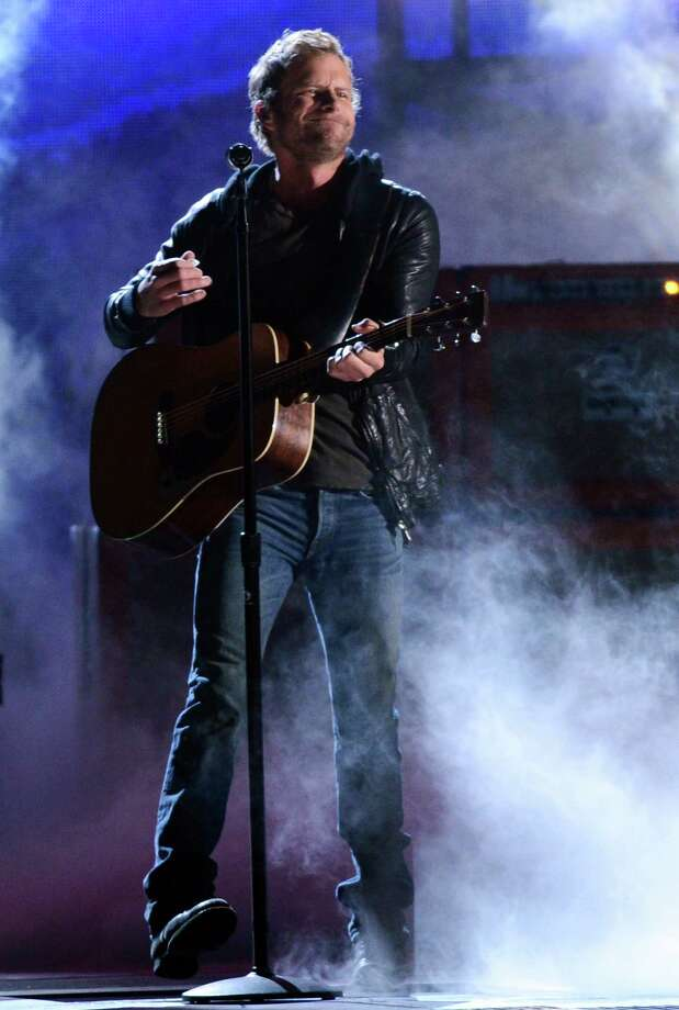 NASHVILLE, TN - NOVEMBER 01:  Dierks Bentley performs during the 46th annual CMA Awards at the Bridgestone Arena on November 1, 2012 in Nashville, Tennessee. Photo: Jason Kempin, Getty Images / 2012 Getty Images