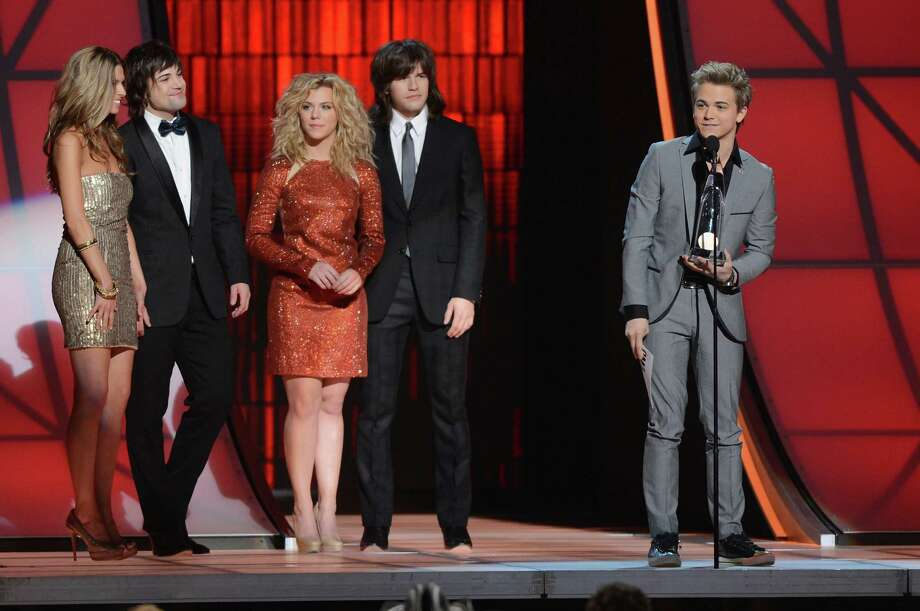 NASHVILLE, TN - NOVEMBER 01:  Hunter Hayes (far right) accepts the award for New Artist of the Year presented by (L-R) Neil Perry (second from left), Kimberly Perry, and Reid Perry of The Band Perry during the 46th annual CMA Awards at the Bridgestone Arena on November 1, 2012 in Nashville, Tennessee. Photo: Jason Kempin, Getty Images / 2012 Getty Images