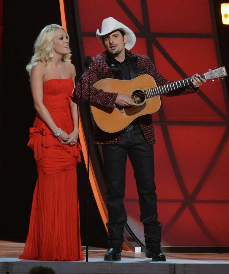 NASHVILLE, TN - NOVEMBER 01:  Co-hosts Carrie Underwood and Brad Paisley present during the 46th annual CMA awards at the Bridgestone Arena on November 1, 2012 in Nashville, United States. Photo: Jason Kempin, Getty Images / 2012 Getty Images
