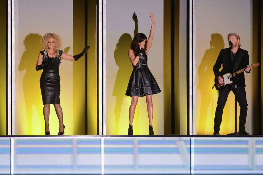 NASHVILLE, TN - NOVEMBER 01:  (L-R) Kimberly Schlapman, Karen Fairchild, and Phillip Sweet of Little Big Town perform during the 46th annual CMA awards at the Bridgestone Arena on November 1, 2012 in Nashville, United States. Photo: Jason Kempin, Getty Images / 2012 Getty Images