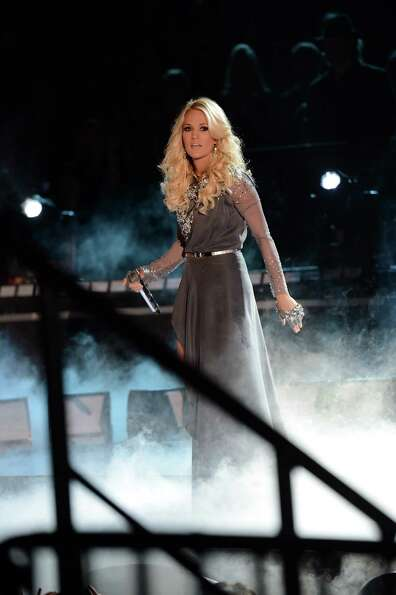 NASHVILLE, TN - NOVEMBER 01:  Carrie Underwood performs during the 46th annual CMA Awards at the Bri
