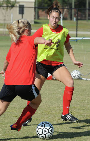 Lamar's Kristin Bos works defense during practice on Tuesday. The Lady Card are preparing for the Southland Conference Tournament. Photo taken Tuesday, October 30, 2012 Guiseppe Barranco/The Enterprise Photo: Guiseppe Barranco, STAFF PHOTOGRAPHER / The Beaumont Enterprise