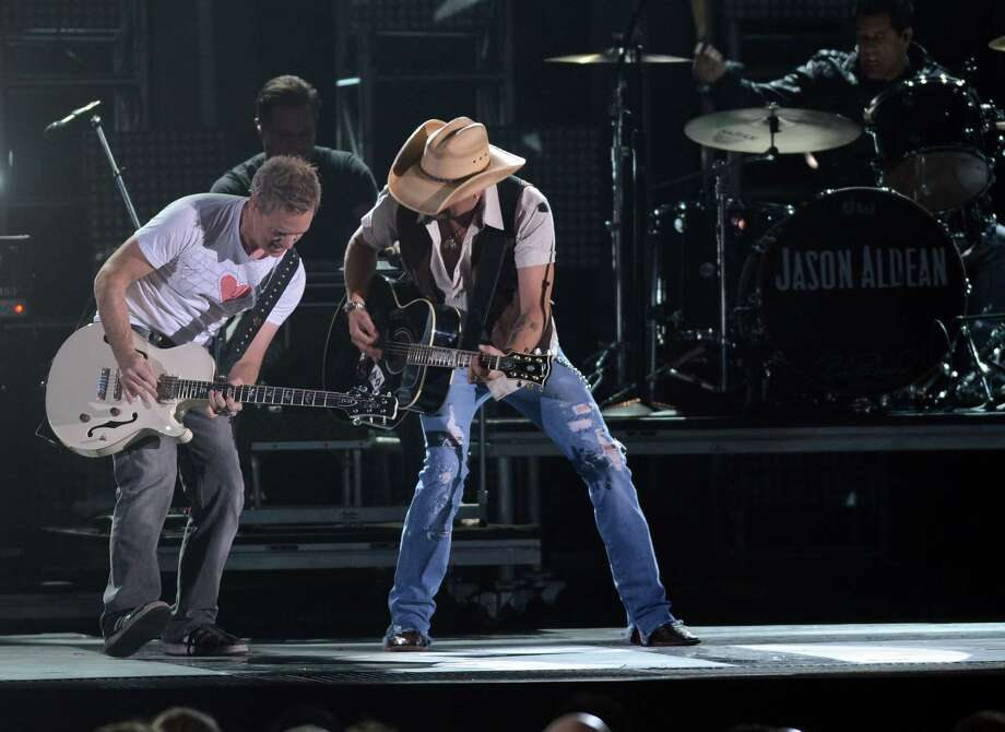 NASHVILLE, TN - NOVEMBER 01:  Jason Aldean (R) performs during the 46th annual CMA Awards at the Bridgestone Arena on November 1, 2012 in Nashville, Tennessee. Photo: Jason Kempin, Getty Images / 2012 Getty Images