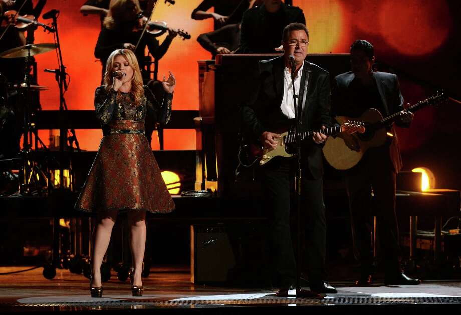 NASHVILLE, TN - NOVEMBER 01:  (L-R) Kelly Clarkson and Vince Gill perform during the 46th annual CMA Awards at the Bridgestone Arena on November 1, 2012 in Nashville, Tennessee. Photo: Jason Kempin, Getty Images / 2012 Getty Images