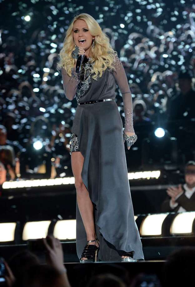 NASHVILLE, TN - NOVEMBER 01:  Carrie Underwood performs during the 46th annual CMA Awards at the Bridgestone Arena on November 1, 2012 in Nashville, Tennessee. Photo: Jason Kempin, Getty Images / 2012 Getty Images