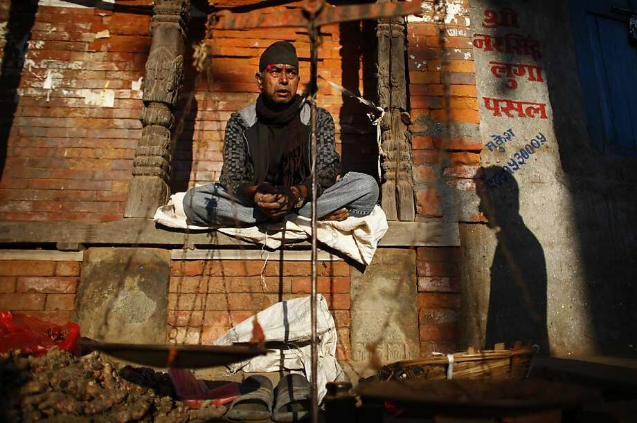 A Nepalese vendor waits for the customers in Bhaktapur, Nepal, Thursday, Nov. 1, 2012. Bhaktapur, or town of devotees, is an ancient Newar community town listed as a World Heritage site. (AP Photo/Niranjan Shrestha) Photo: Niranjan Shrestha, Associated Press
