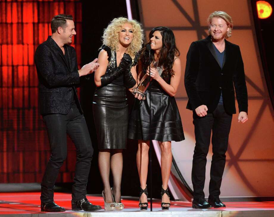 NASHVILLE, TN - NOVEMBER 01:  (L-R) Jimi Westbrook, Kimberly Schlapman, Karen Fairchild, and Phillip Sweet of Little Big Town accept the award for Vocal Group of the Year during the 46th annual CMA Awards at the Bridgestone Arena on November 1, 2012 in Nashville, Tennessee. Photo: Jason Kempin, Getty Images / 2012 Ed Rode