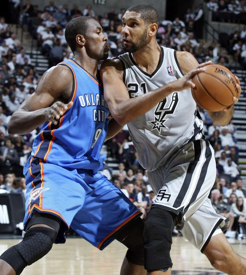 San Antonio Spurs' Tim Duncan looks for room around Oklahoma City Thunder's Serge Ibaka during first half action Thursday Nov. 1, 2012 at the AT&T Center. (Edward A. Ornelas / San Antonio Express-News)