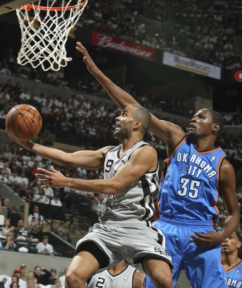 San Antonio Spurs' Tony Parker shoots around Oklahoma City Thunder's Kevin Durant during first half action Thursday Nov. 1, 2012 at the AT&T Center. (Edward A. Ornelas / San Antonio Express-News)