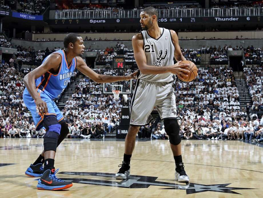 San Antonio Spurs' Tim Duncan looks for room around Oklahoma City Thunder's Kevin Durant during first half action Thursday Nov. 1, 2012 at the AT&T Center. (Edward A. Ornelas / San Antonio Express-News)