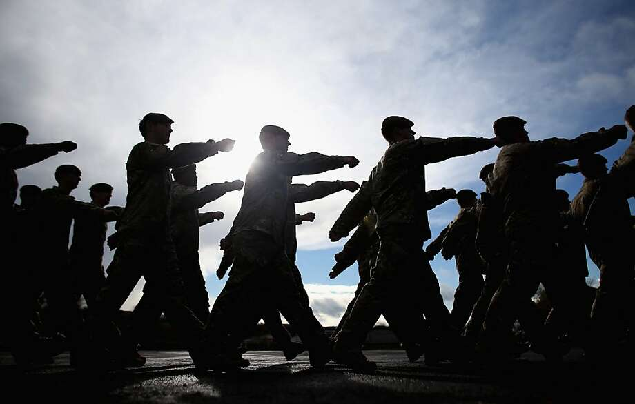 Soldiers from 1st Battalion The Royal Anglian Regiment (The Vikings) march from the parade ground after they received their Afghanistan Operational Service Medals at Picton Barracks on November 1, 2012 in Bulford, England. The parade was the first in a series of events marking the end of their successful six-month deployment to Afghanistan as part of Task Force Helmand.  The parade comes during the same week that two more British soldiers were shot dead at a checkpoint in Afghanistan by a man wearing a local police uniform.  (Photo by Matt Cardy/Getty Images) Photo: Matt Cardy, Getty Images