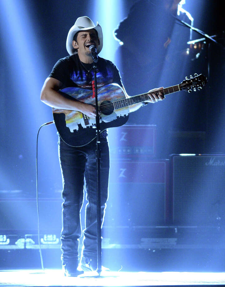 NASHVILLE, TN - NOVEMBER 01:  Brad Paisley performs during the 46th annual CMA Awards at the Bridgestone Arena on November 1, 2012 in Nashville, Tennessee. Photo: Jason Kempin, Getty Images / 2012 Getty Images
