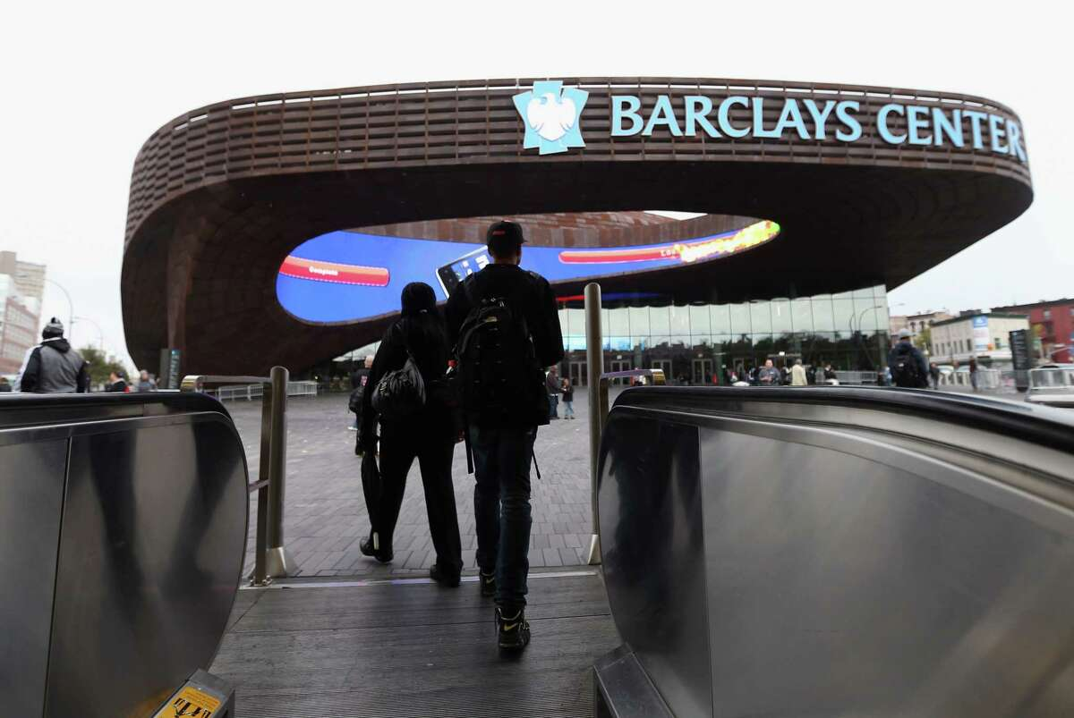 FILE - OCTOBER 31, 2012: After the NBA initially said the season opener between the Brooklyn Nets and New York Knicks at the new Barclays Center in Brooklyn would go on as scheduled in the wake of Hurricane Sandy, New York City Mayor Michael Bloomberg's office was expected to announce on October 31, 2012 that it would instead be postponed. NEW YORK, NY - OCTOBER 19: Fans arrive via subway for the preseason game between the Philadelphia 76ers and the Brooklyn Nets at the Barclays Center on October 19, 2012 in the Brooklyn borough of New York City. NOTE TO USER: User expressly acknowledges and agrees that, by downloading and/or using this photograph, user is consenting to the terms and conditions of the Getty Images License Agreement. (Photo by Bruce Bennett/Getty Images)