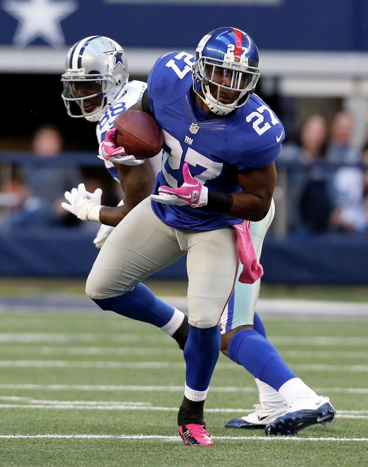 New York Giants strong safety Stevie Brown (27) intercepts a pass from Dallas Cowboys' Tony Romo during the first half of an NFL football game Sunday, Oct. 28, 2012 in Arlington, Texas. (AP Photo/Sharon Ellman)