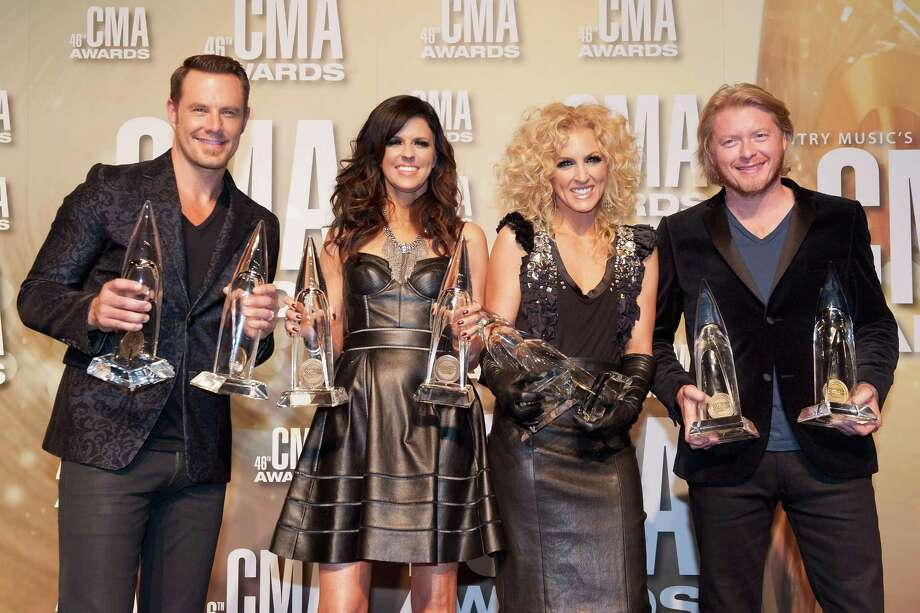 NASHVILLE, TN - NOVEMBER 01:  (L-R) Jimi Westbrook, Karen Fairchild, Kimberly Schlapman and Phillip Sweet of Little Big Town pose with their awards at the 46th annual CMA Awards at the Bridgestone Arena on November 1, 2012 in Nashville, Tennessee. Photo: Erika Goldring, Getty Images / 2012 Getty Images