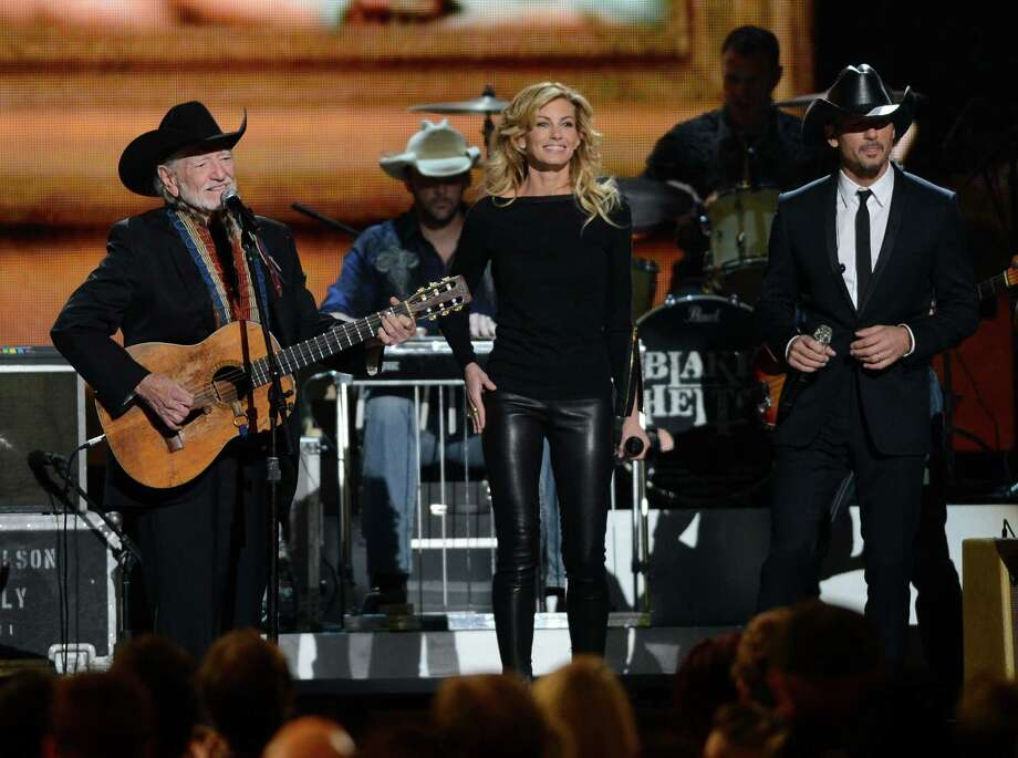 NASHVILLE, TN - NOVEMBER 01:  (L-R) Willie Nelson, Faith Hill, and Tim McGraw perform during the 46th annual CMA Awards at the Bridgestone Arena on November 1, 2012 in Nashville, Tennessee. Photo: Jason Kempin, Getty Images / 2012 Getty Images