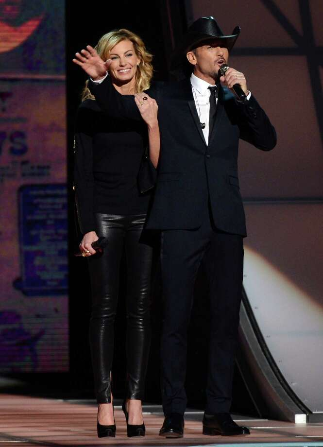 NASHVILLE, TN - NOVEMBER 01:  Faith Hill and Tim McGraw speak onstage during the 46th annual CMA Awards at the Bridgestone Arena on November 1, 2012 in Nashville, Tennessee. Photo: Jason Kempin, Getty Images / 2012 Getty Images
