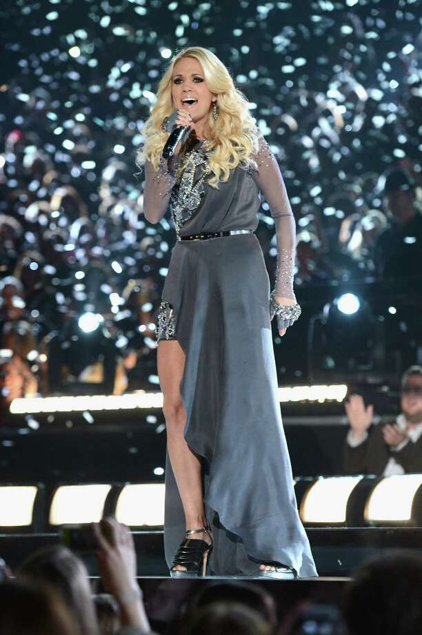 NASHVILLE, TN - NOVEMBER 01:  Carrie Underwood performs during the 46th annual CMA awards at the Bridgestone Arena on November 1, 2012 in Nashville, United States. Photo: Jason Kempin, Getty Images / 2012 Getty Images