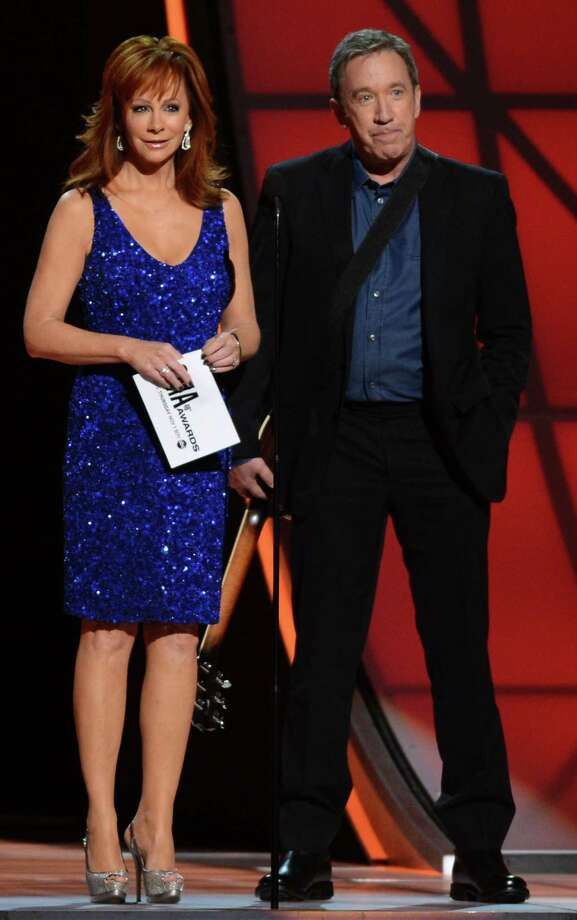 NASHVILLE, TN - NOVEMBER 01:  Reba McEntire and Tim Allen speak onstage during the 46th annual CMA Awards at the Bridgestone Arena on November 1, 2012 in Nashville, Tennessee. Photo: Jason Kempin, Getty Images / 2012 Getty Images