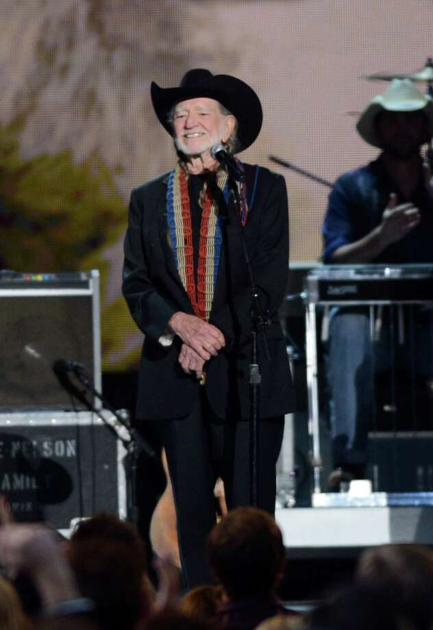 NASHVILLE, TN - NOVEMBER 01:  Willie Nelson performs during the 46th annual CMA Awards at the Bridgestone Arena on November 1, 2012 in Nashville, Tennessee. Photo: Jason Kempin, Getty Images / 2012 Getty Images