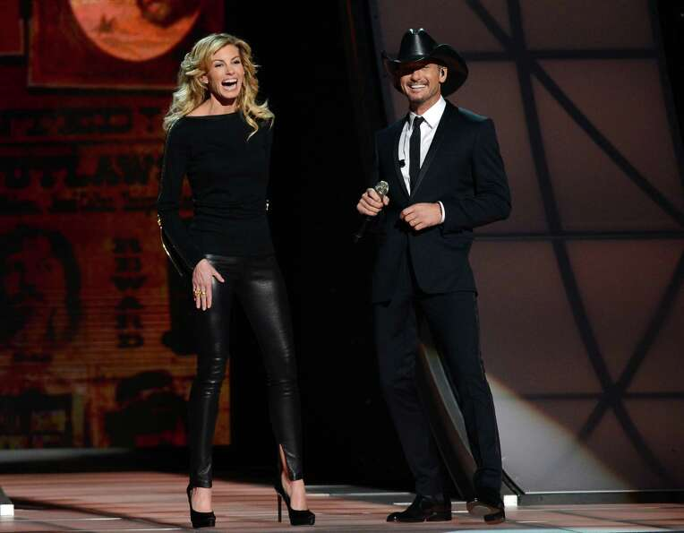 NASHVILLE, TN - NOVEMBER 01:  Faith Hill and Tim McGraw speak onstage during the 46th annual CMA Awa