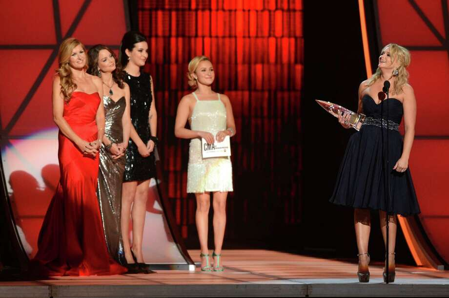 NASHVILLE, TN - NOVEMBER 01:  Miranda Lambert (far right) accepts an award onstage presented by (L-R) Connie Britton, Kimberly Williams-Paisley, and Hayden Panettiere (second from right) during the 46th annual CMA Awards at the Bridgestone Arena on November 1, 2012 in Nashville, Tennessee. Photo: Jason Kempin, Getty Images / 2012 Getty Images