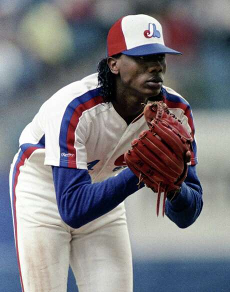 FILE - In this June 6, 1989, file photo, Montreal Expos pitcher Pascual Perez stares towards home plate during baseball action against the St. Louis Cardinals in Montreal. The former major league pitcher, who had a troubled 11-season career that included two suspensions for drug use, was killed at his home in the Dominican Republic in an apparent robbery, police said Thursday, Nov. 1, 2012. (AP Photo/The Canadian Press, Paul Chiasson, File) Photo: Paul Chiasson, SUB / CP