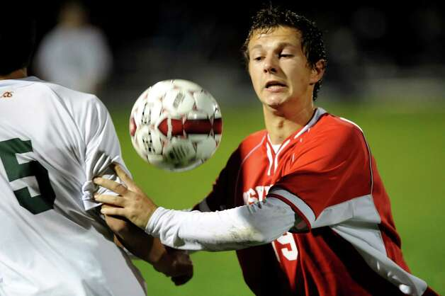 Niskayuna's Phillip Webster (19), right, (2), goes for a loose ball during their Section II Class AA boys' soccer semifinals against Shenendehowa on Thursday, Nov. 1, 2012, at Colonie High in Colonie, N.Y. (Cindy Schultz / Times Union) Photo: Cindy Schultz / 00019899A