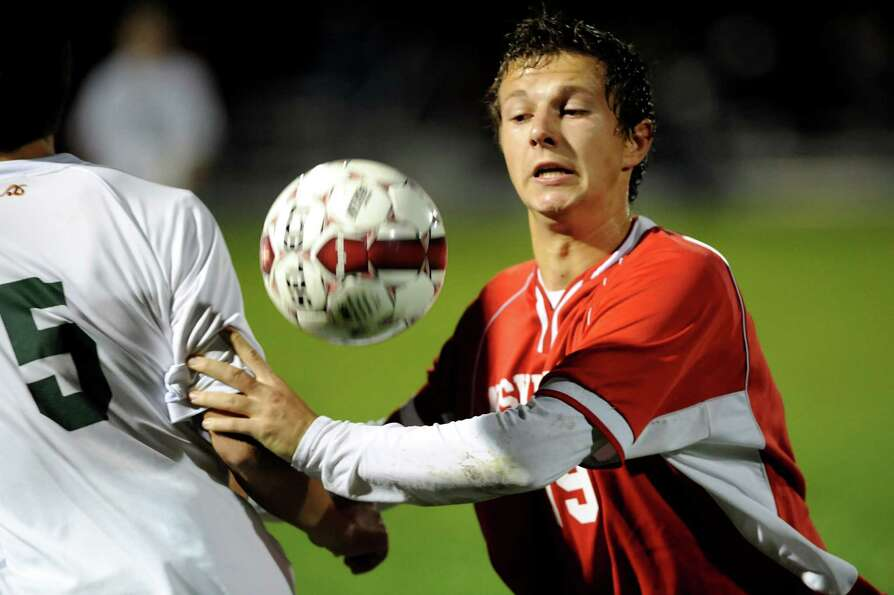 Niskayuna's Phillip Webster (19), right, (2), goes for a loose ball during their Section II Class AA