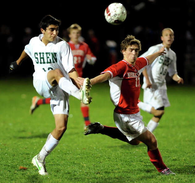 Shenendehowa's Chris Ortega (10) passes the ball as Niskayuna's Christian Koudal (17), left, defends