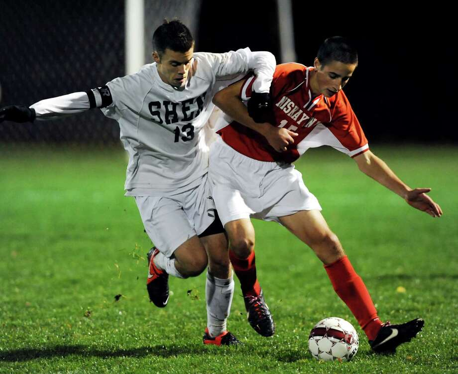 Shenendehowa's Chris Schmid (13), left, and Niskayuna's Nick Shanahan (15) battle for the ball during their Section II Class AA boys' soccer semifinals on Thursday, Nov. 1, 2012, at Colonie High in Colonie, N.Y. (Cindy Schultz / Times Union) Photo: Cindy Schultz / 00019899A