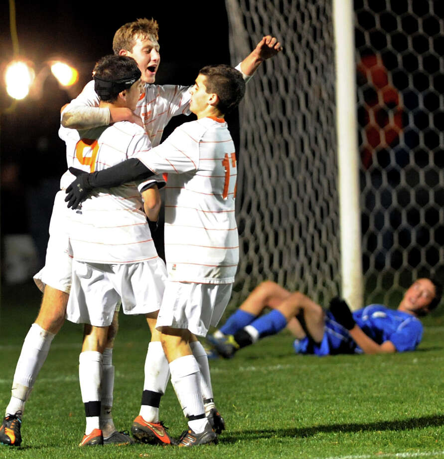 Bethlehem's Liam Roohan (23), center, celebrates his goal with teammates Ethan Strauss (9), left, and Zach Stryker (17) during their Section II Class AA boys' soccer semifinals against Albany on Thursday, Nov. 1, 2012, at Colonie High in Colonie, N.Y. (Cindy Schultz / Times Union) Photo: Cindy Schultz / 00019899A