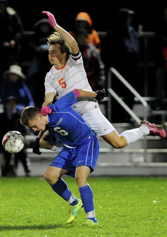 Bethlehem's Jeremy Shuman (5), top, and Albany's Denis Leon (6) collide as they go for a header during their Section II Class AA boys' soccer semifinals against Albany on Thursday, Nov. 1, 2012, at Colonie High in Colonie, N.Y. (Cindy Schultz / Times Union) Photo: Cindy Schultz / 00019899A