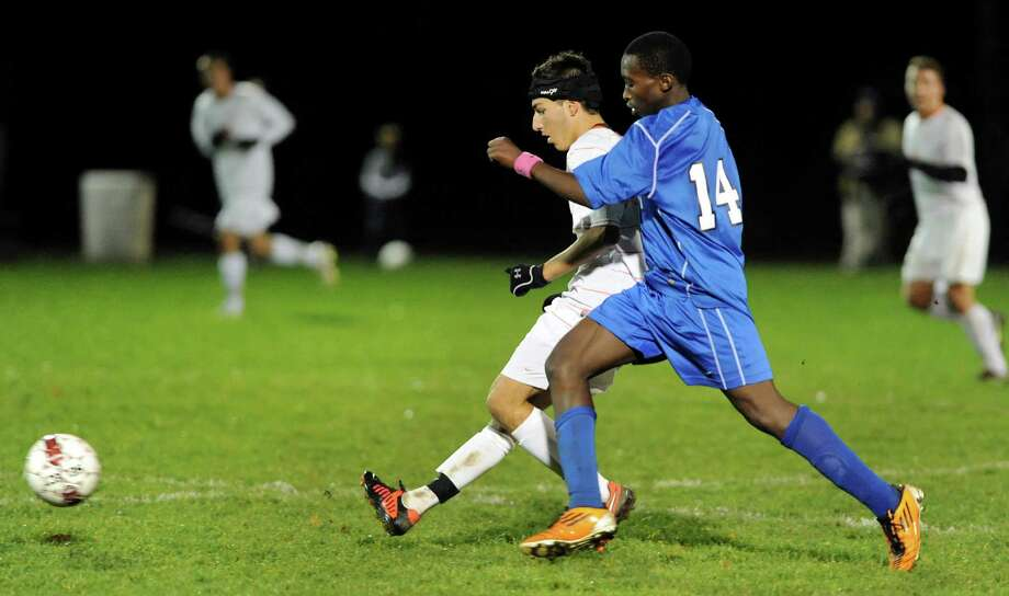 Bethlehem's Ethan Strauss (9), left, passes the ball as Albany's Erick Kwizera (14) defends during their Section II Class AA boys' soccer semifinals against Albany on Thursday, Nov. 1, 2012, at Colonie High in Colonie, N.Y. (Cindy Schultz / Times Union) Photo: Cindy Schultz / 00019899A