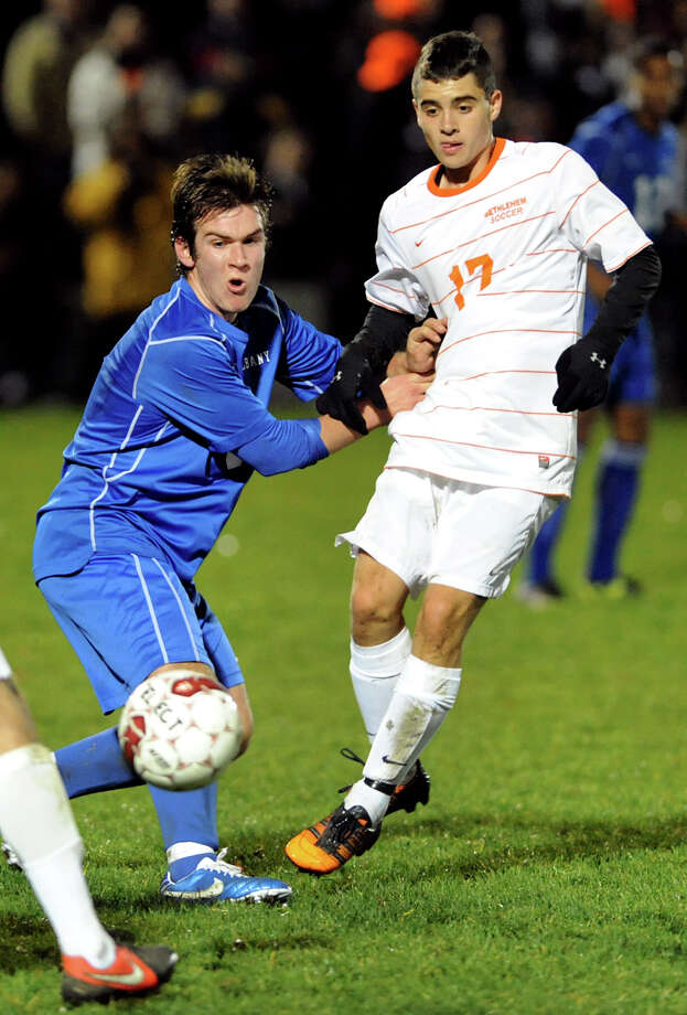 Bethlehem's Zach Stryker (17), right passes the ball as Albany's Brendan Kelley (8) defends during their Section II Class AA boys' soccer semifinals against Albany on Thursday, Nov. 1, 2012, at Colonie High in Colonie, N.Y. (Cindy Schultz / Times Union) Photo: Cindy Schultz / 00019899A
