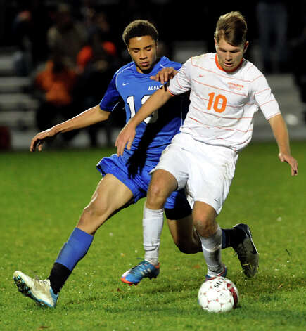 Bethlehem's Ethan Gunty (10), right, controls the ball as Albany's Jaheem Lawitz (13) defends during their Section II Class AA boys' soccer semifinals against Albany on Thursday, Nov. 1, 2012, at Colonie High in Colonie, N.Y. (Cindy Schultz / Times Union) Photo: Cindy Schultz / 00019899A