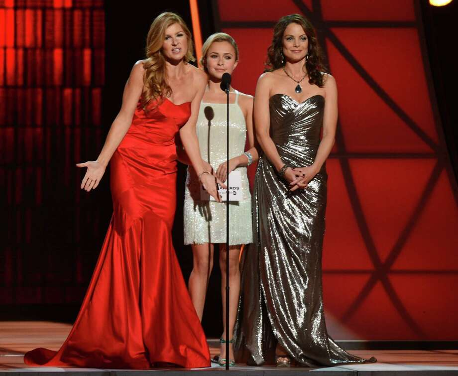 NASHVILLE, TN - NOVEMBER 01:  (L-R) Connie Britton, Hayden Panettiere, and Kimberly Williams-Paisley present during the 46th annual CMA Awards at the Bridgestone Arena on November 1, 2012 in Nashville, Tennessee. Photo: Jason Kempin, Getty Images / 2012 Getty Images