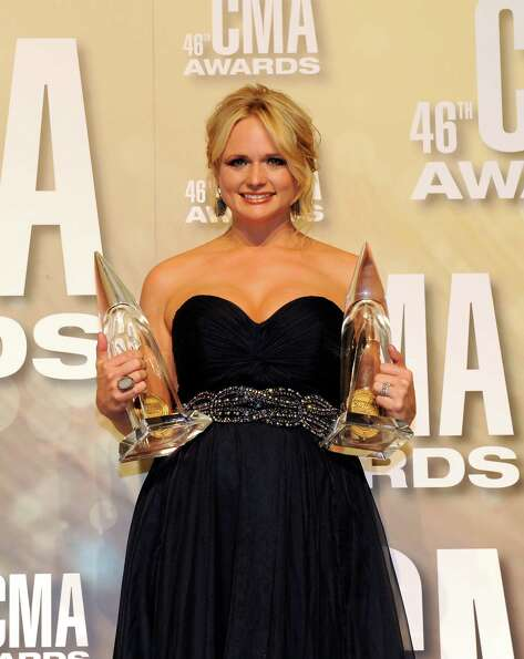 NASHVILLE, TN - NOVEMBER 01:  Miranda Lambert poses with awards at the 46th annual CMA Awards at the