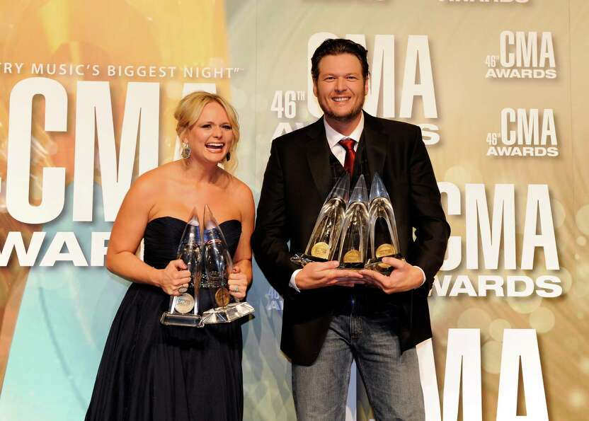 NASHVILLE, TN - NOVEMBER 01:  Miranda Lambert and Blake Shelton pose with awards at the 46th annual