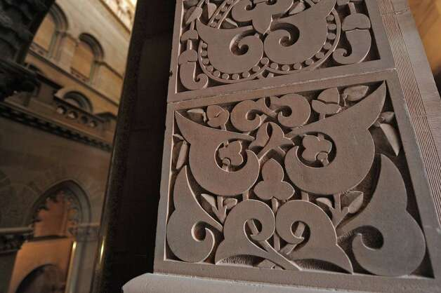 A view of some of the carvings on a column on the stairwell on the Senate side of the capitol building on Wednesday, Oct. 31, 2012 in Albany, NY.   (Paul Buckowski / Times Union) Photo: Paul Buckowski