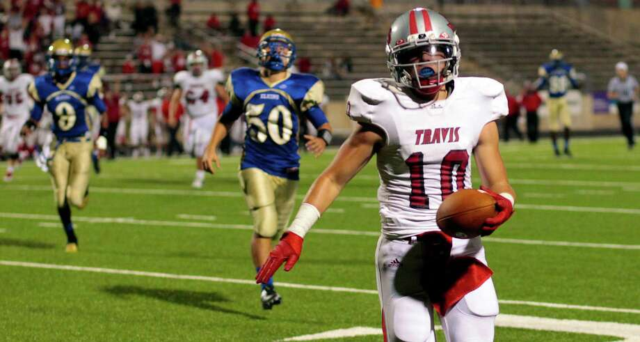 Travis tight end Marshall Green streaks to the end zone for a touchdown during the first half of Travis' win over Elkins on Thursday night at Hall Stadium. Photo: Billy Smith II, Staff / © 2012 Houston Chronicle