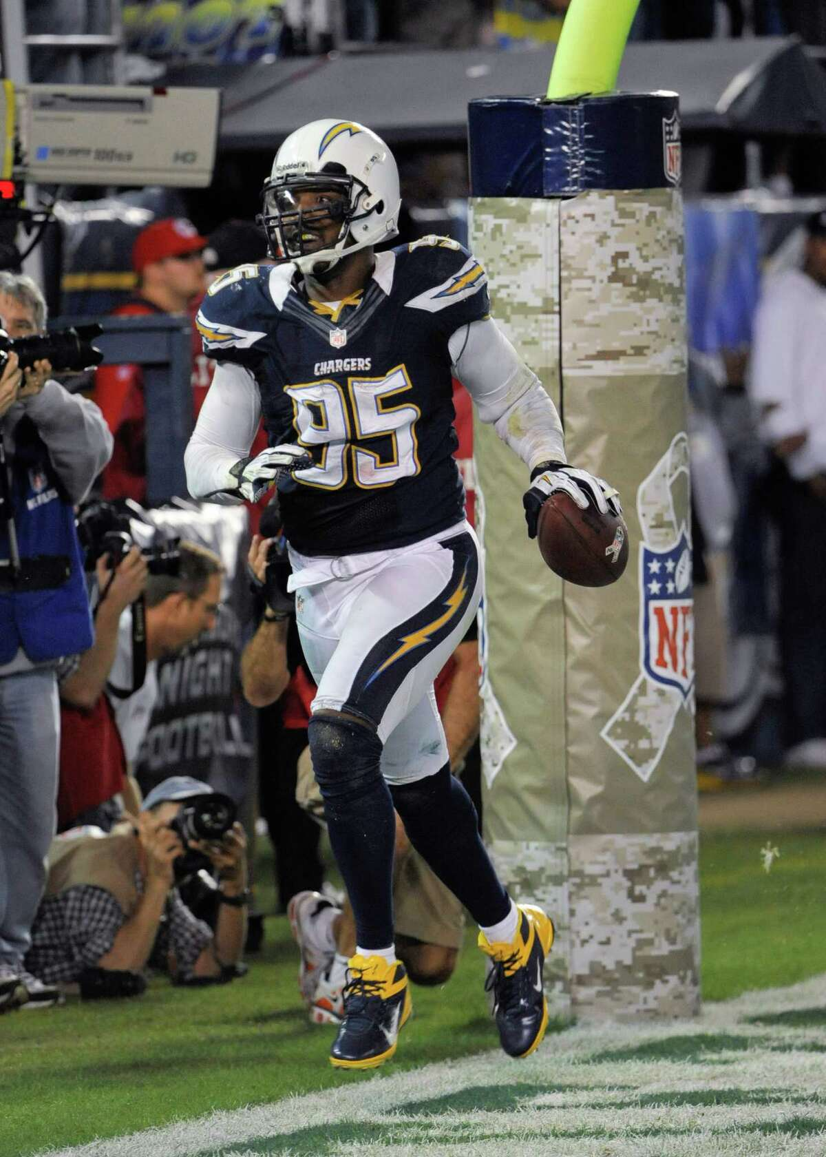 San Diego Chargers linebacker Shaun Phillips celebrates after recovering a Kansas City Chiefs' fumble in the end zone for a touchdown during the second half of the Chargers' 31-13 victory in an NFL football game Thursday, Nov. 1, 2012, in San Diego. (AP Photo/Denis Poroy)